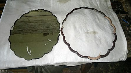 Repair of mirror, broken and water-damaged in house fire.