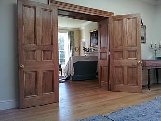 Large doors and panelling made from oak from customer's own garden.