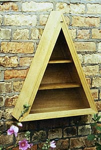 Triangular cabinet in quarter-sawn oak, with concealed soss hinges and triangular spring-catch
