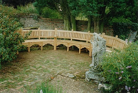 Semi-circular garden seat in oak, in three sections