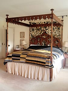 Four poster bed in mahogany