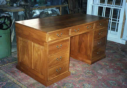 Brown oak knee-hole desk