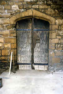 Conservation of 15th century doors to old Bishop's Palace