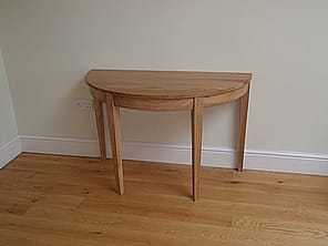 One of a pair of console tables